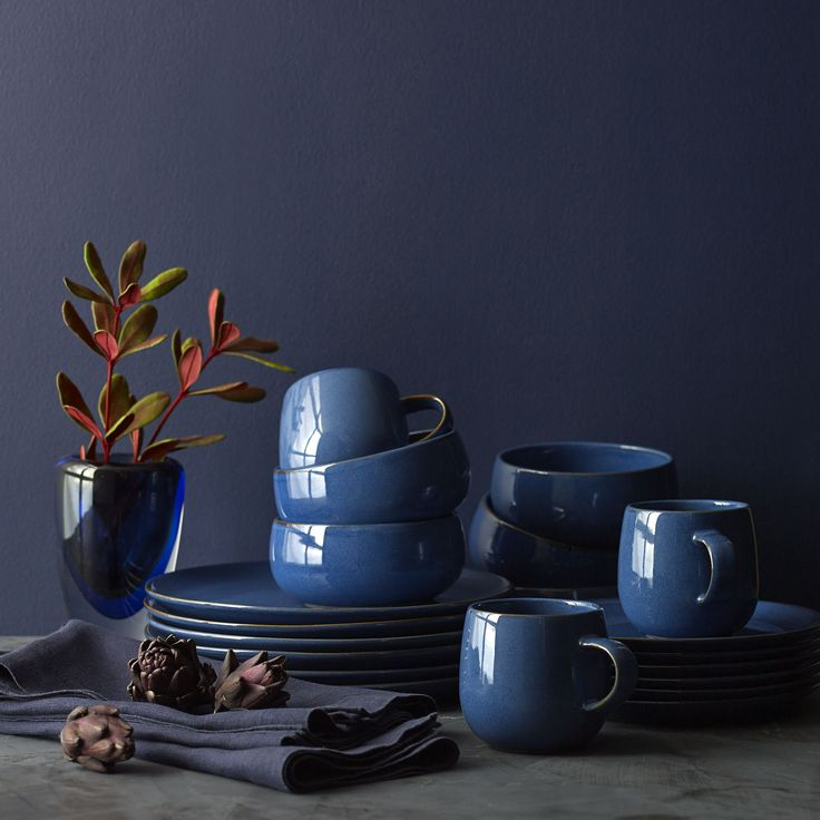 Deep blue pools calming color on the everyday table in Aaron Probyn's serene dinnerware collection. Simple, rounded shapes in versatile stoneware offer a friendly, relaxed feel.