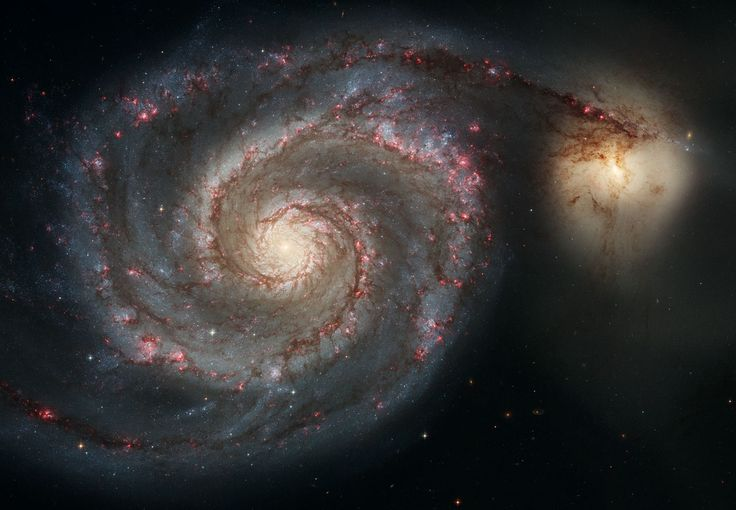 The Whirlpool Galaxy: Hubble took this spectacular image of the Whirlpool Galaxy (M51) and its smaller companion galaxy in 2005 with the Advanced Camera for Surveys (ACS). The angle gives us a great view of the amazing spiral arms of this galaxy, which is 25 million light years away.
