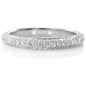 This dazzling micro pave wedding band, Design 2875 from Knox Jewelers, features a 1.02 total carat weight. Three rows of diamonds form a slightly domed band that with dance and sparkle in any light. #weddingband #micropave