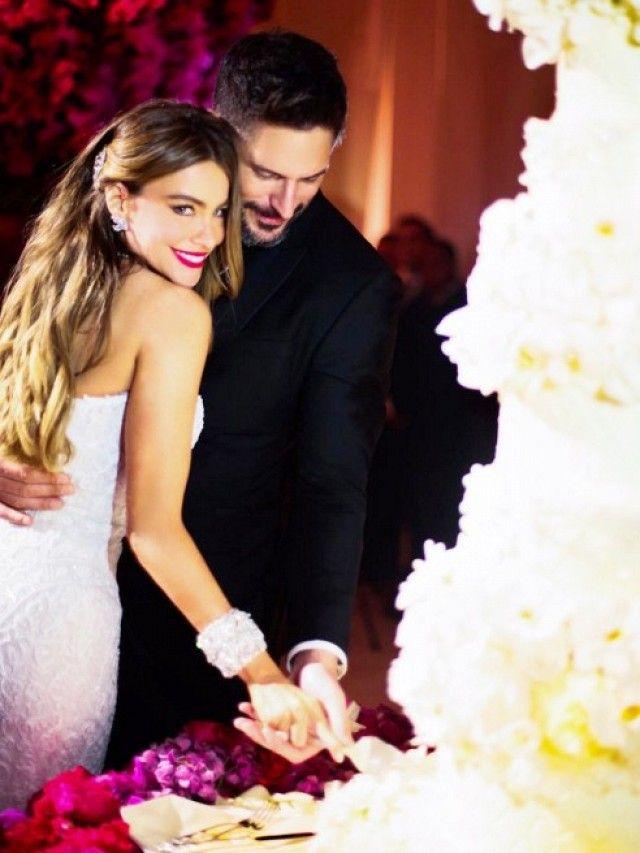 Sofia Vergara wears a custom Zuhair Murad wedding gown with husband Joe Manganiello.