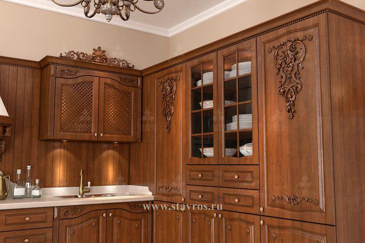 Дизайн-проект кухонной мебели, выполненной из массива дерева и украшенной резными декоративными элементами. The design project of kitchen furniture made from solid wood and decorated with carved decorative elements.