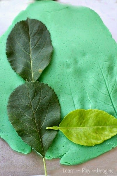 Making letters out of leaves with playdough - play based fall activities for preschool and kindergarten