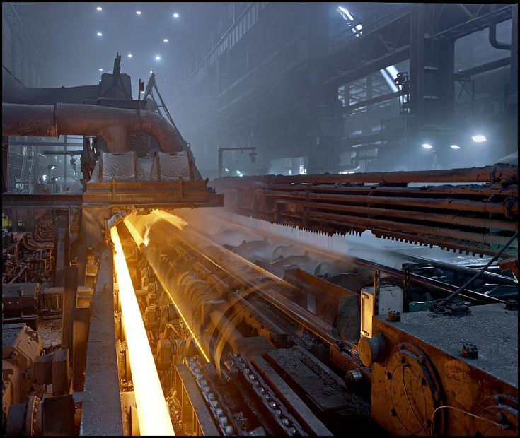 Great site with lots of pictures of industrial metal working  Here we see a tube mill making pierced tube