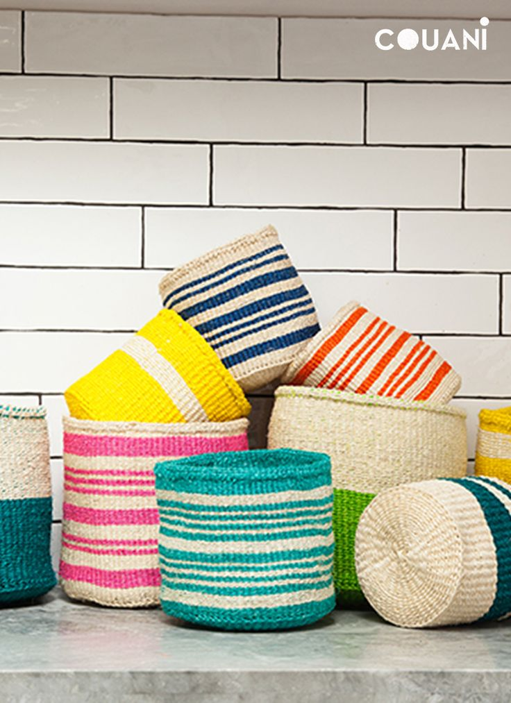 COUANI Catalogue 2014 // hand woven sisal baskets in a range of pop colours and patterns //