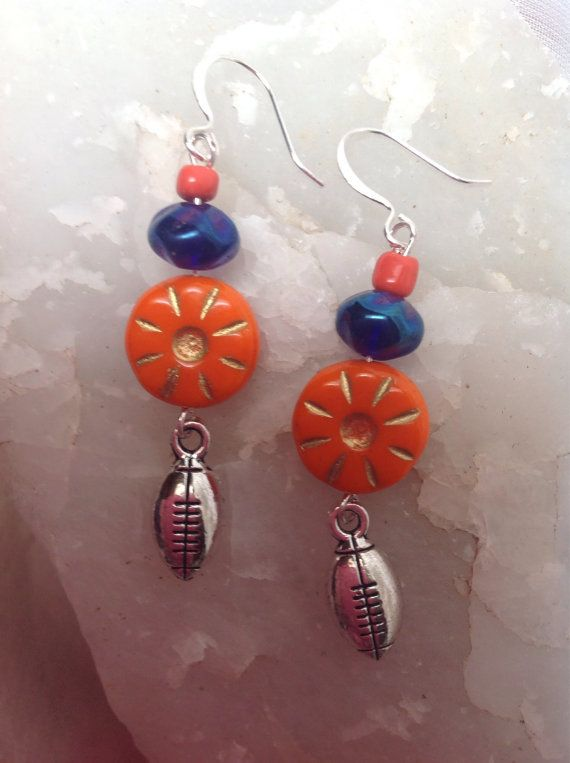 Denver bronco colored football earrings by Recyclefunjewelry, $10.00
