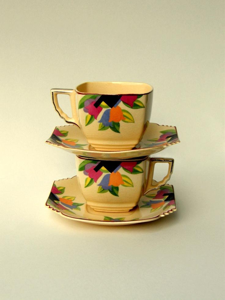 Art Deco Cup & Saucer, Modernistic Sienna Ware Deco Tulip Design - RESERVED for Kyle Hepp Wedding Gift Registry. $40.00, via Etsy.