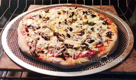#Pizza #baked on a #pizzascreen is a great, #easy way to get a #homemade #pizzapie on a #pizzastone. #bake it on a #screen only or stack the screen on a #stone. Either way, it makes a great #pizzeria style #pie ... and a pizza screen is very easy to clean using a brush. Oil your screen for best results. I like to spray my screen before putting the pie on it. Remember, always bake your pizza on the lowest shelf of your #oven. #recipes @ http://www.foodcult.com/pizzas.com