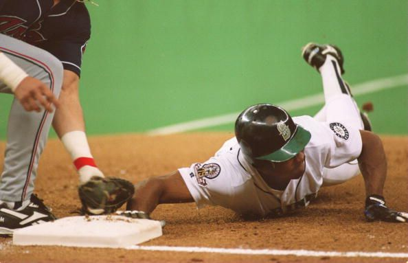 SEATTLE RIGHT FIELDER VINCE COLEMAN BEATS OUT THE TAG OF CLEVELAND FIRST BASEMAN JIM THOME DURING THE SECOND INNING OF THE INDIANS GAME VERSUS THE...