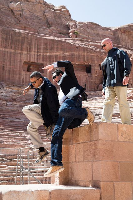 President Barack Obama and Dr. Suleiman A.D. Al Farajat, a University of Jordan tourism professor, jump from a ledge of the Nabataean Amphit...
