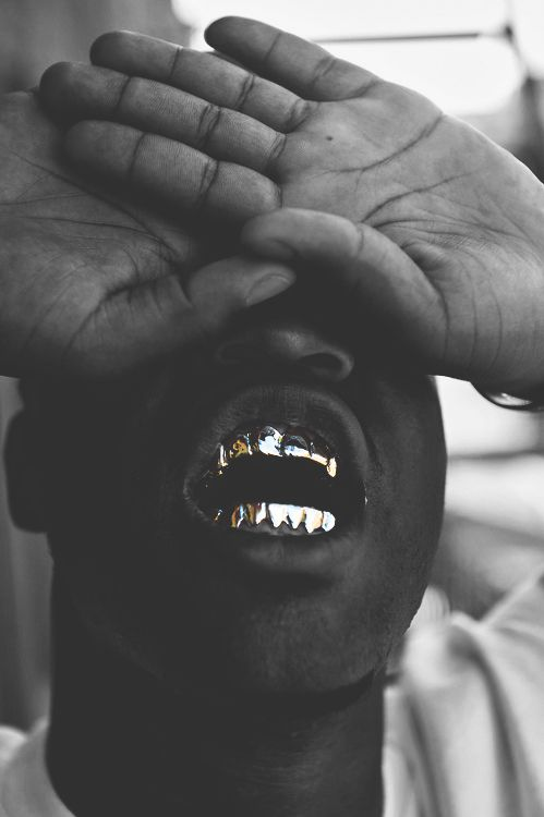 This Would Be A Good Contents Page For My Magazine Because The Picture Is Highlighting His Gold Teeth Which Big Rap Symbol
