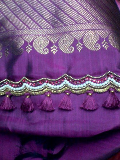 Silk saree pallu enriched with embroidery and kuchu.. innovative by Apoorva Embroidery