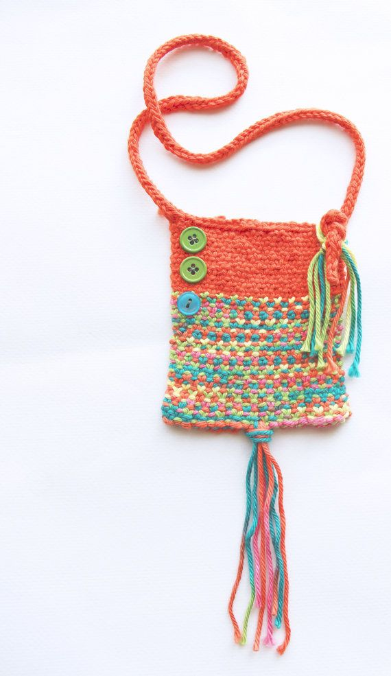 I love making jewelry out of soft, light material, such as yarn, and especially with bright colors. This bright, energetic piece, slips over the