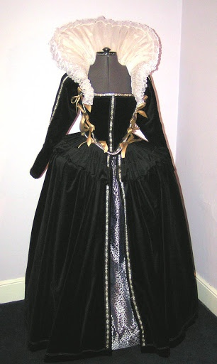 Elizabethan Gown-EXCERPT: Inspired by a portrait of Elizabeth Brydges 1589, the black velvet corseted gown is worn over the wheel farthingale with supporting bumroll and brocaded petticoat.