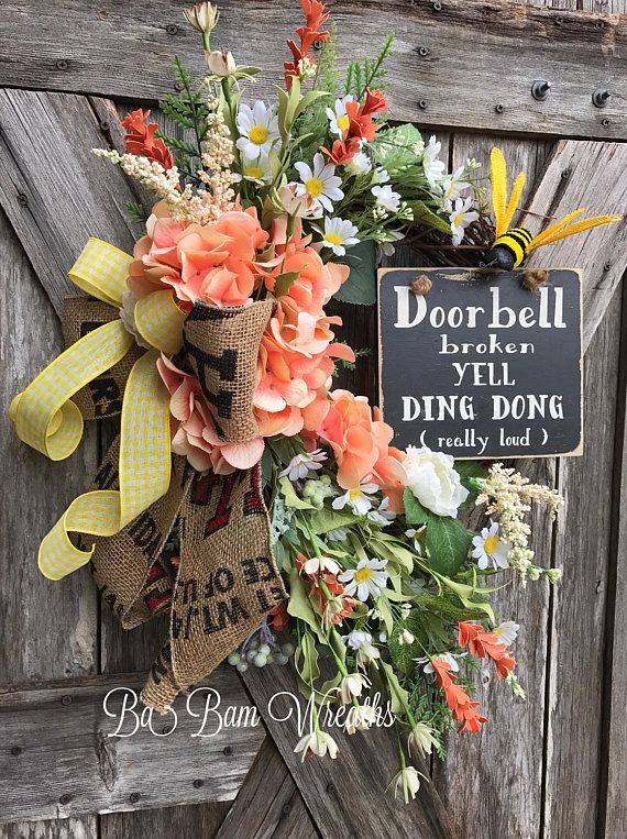 Floral Wreath, Spring Wreath, Summer Wreath, Primitive Wreath, Door Wreath  Door Bell Broken~ Yell Ding Dong (really loud)! Let your Door have some FUN while expressing some personality. Made on a grapevine wreath base and filled with a beautiful assortment of wildflowers in hues of peach, cream white, greens and yellows. A big burlap bow made from a potato sack adds tons of character as does the hilarious wooden sign. Notice the details~ a bee is buzzing by to say Hi!  Measures 30 inches…