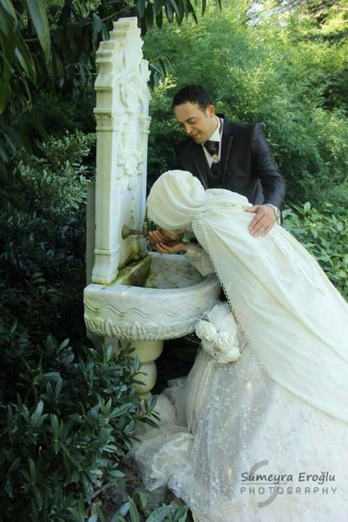 A wife taking water from her husband's hand.
