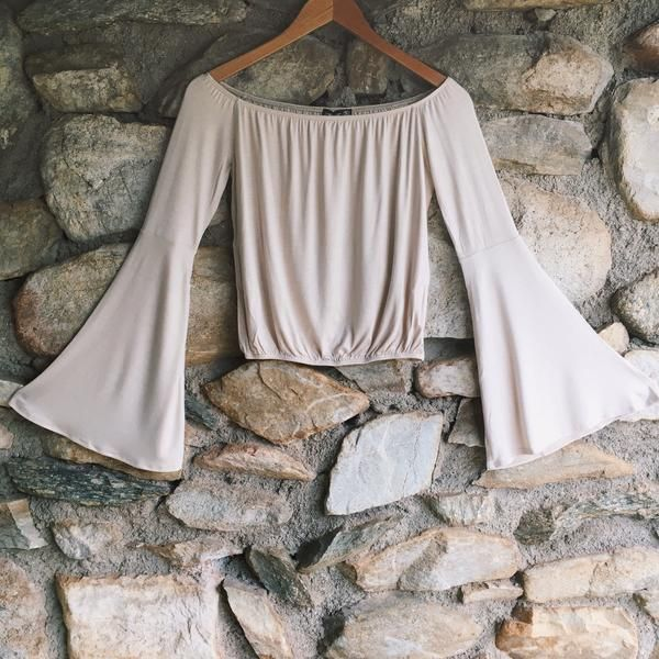 Give off that 70s vibe with this Off The Shoulder Bell Sleeve Crop Top in Taupe, featuring bell sleeves and an elastic bottom. | Shop Affordable Hippie Clothing