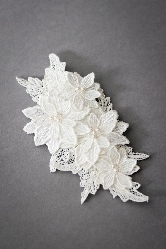 Floral lace comb.. My mother got married with something similar to this in her hair.