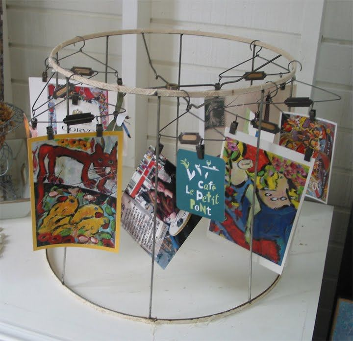old lampshade used with little clips to hold just about anything
