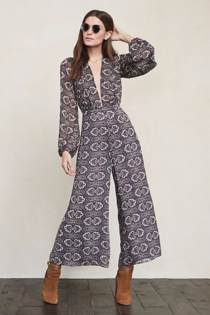 In case you haven't noticed, we're pretty into plunging necklines around here. The Darla Jumpsuit is yet another ultra flattering thing that let's you show off a bit without feeling overexposed. This is a georgette jumpsuit with a deep V neckline, sheer puffed long sleeves and a hook/zip closure in the back.    https://www.thereformation.com/products/darla-jumpsuit-milton?utm_source=pinterest&utm_medium=organic&utm_campaign=PinterestOwnedPins