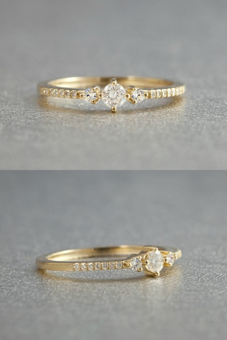 Tastefully delicate engagement ring. Three small, beautiful diamonds flanked by a row of pave accents. Low profile, elegant and feminine!