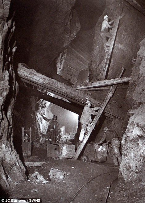 Precarious: Miners clambered up rickety ladders and under the precarious timber beams holding the mine shaft together
