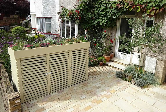 We now have to accommodate three large wheelie bins in our front gardens in Barnet and rather than have to look at them every day I set about designing a stora