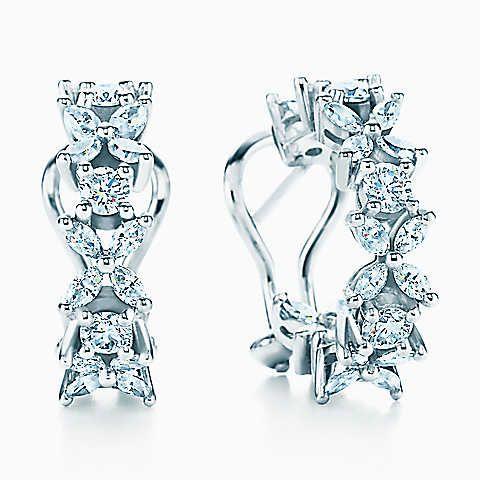 Tiffany Victoria™ alternating hoop earrings in platinum with diamonds.