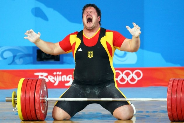 Inspirational Moments: Olympic celebrations - BEIJING - AUGUST 19: Matthias Steiner of Germany celebrates winning the gold medal in the Men's 105 kg group weightlifting event at the Beijing University of Aeronautics & Astronautics Gymnasium on Day 11 of the Beijing 2008 Olympic Games on August 19, 2008 in Beijing, China. (Photo by Julian Finney/Getty Images)