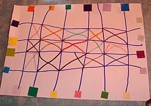 des points autour de la feuille A3, des gommettes carrées collées sur les points : un quadrillage et des croisillons dans les cases du centre.