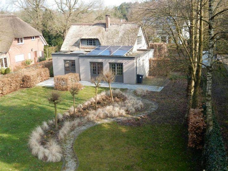 Villa te koop in Kalmthout - 3 slaapkamers - 200m² - 465 000 € - Logic-immo.be - Stijlvolle villa met rieten kap in groene kindvriendelijke omgeving, op 1.348m², met riante woonruimte, prachtige keuken, 3 slpks, 2 badks en mooie zuid-geörienteerde tuin. EPC: 280 kWh/m² (vg,wg,gdv,...