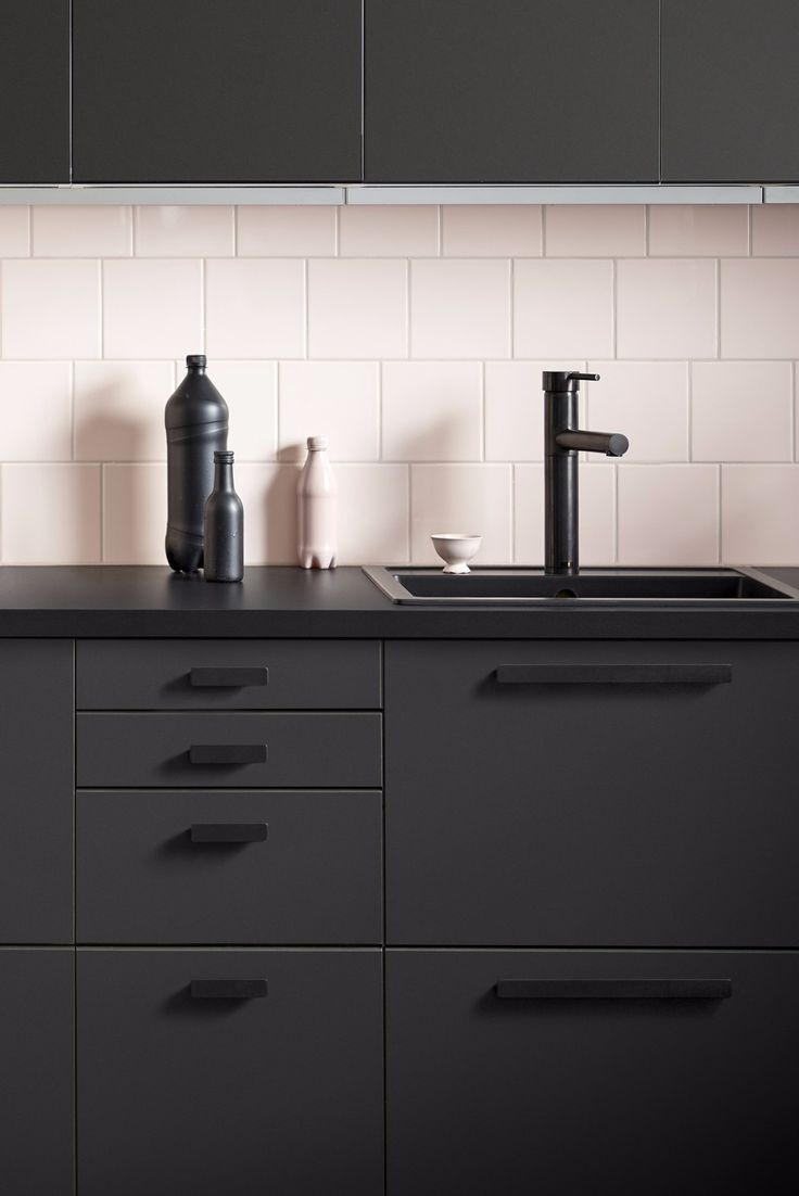 Ikea Kungsbacka kitchen but with lighter counter and handles. Would not do a busy floor with dark cabinets.