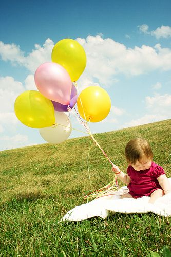 Colorful balloons and baby