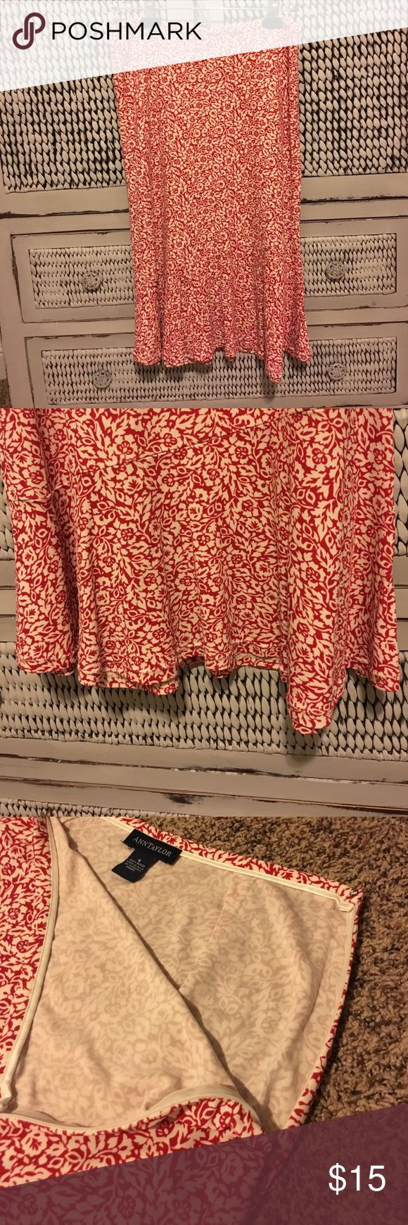 """ANN TAYLOR """"MIDI SKIRT"""" HOT TREND NOW! ANN TAYLOR """"""""midi skirt"""" hangs just below knees. Skirt hangs with a fluttering look at the bottom. Zip up side (see pic) 100% rayon. Red with a white floral pattern.  Excellent condition.  Women's size 6. SOOO CUTE😍 Ann Taylor Skirts Midi"""