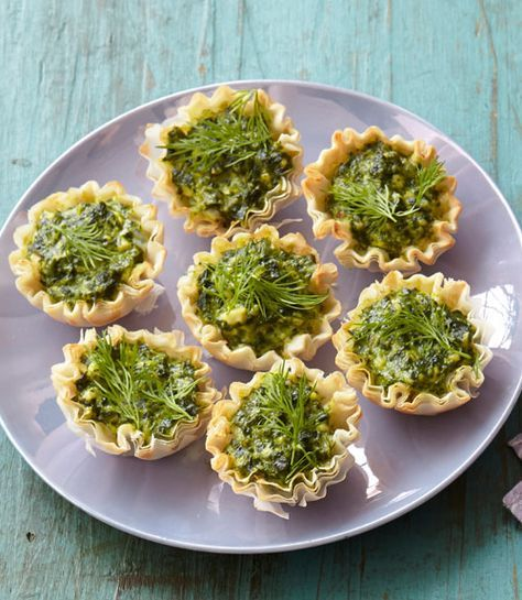 These savory tartlets are inspired by flavors of the Mediterranean. Reminiscent of Greek spanakopita, they combine spinach, feta cheese, and fresh dill in a crunchy phyllo dough shell. Get the recipe here.    - WomansDay.com