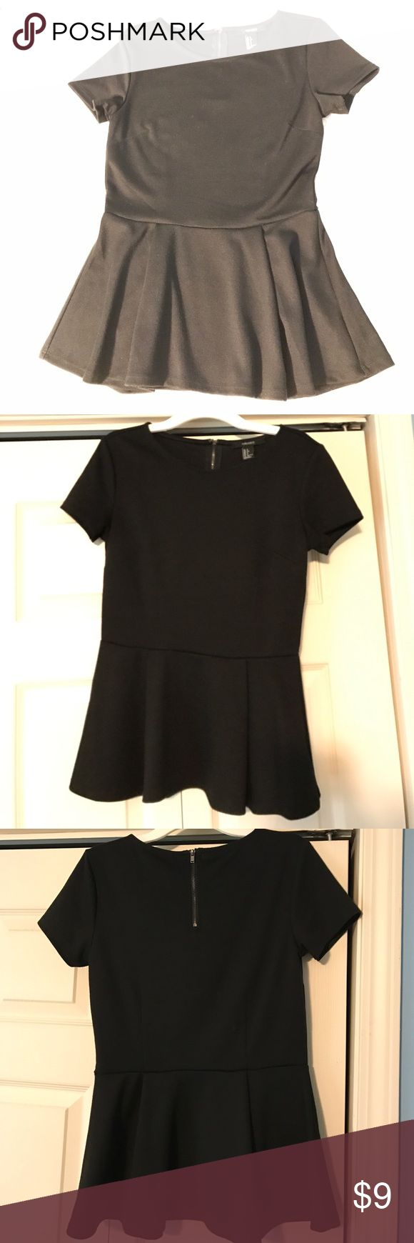 """Black Short-sleeve Peplum Top This black peplum would look beautiful with jeans or a skirt. It's a quality made top and the peplum hits where it's most flattering. Has a zipper and clasp, which is rare to find on a top. Comfortable material and flattering silhouette. Length is 24"""" Forever 21 Tops"""