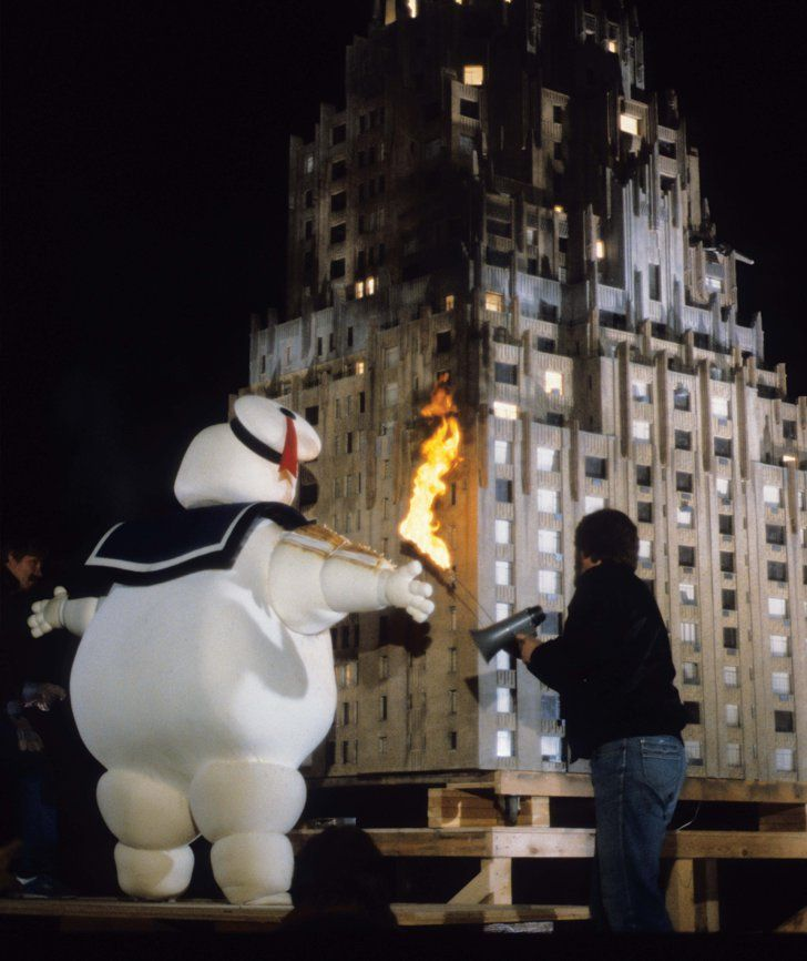 Pin for Later: You'll Never Watch Ghostbusters the Same Way After Seeing These Rare Pictures  Inside a fireproof Stay Puft costume, a stunt performer prepared to be ignited by Joe Viskocil.
