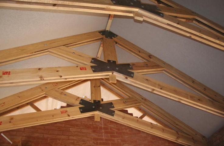 construction dimensional lumber built up into scissors trusses...