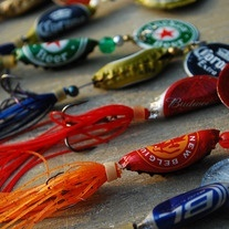 fishing lures made from old bottlecaps. so redneck...love it! They would also make good, rustic decoations if you made a lot and hung them from a banister. New cabin decorating fad?