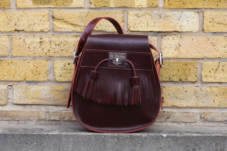 Dr. Martens Tassled Saddle Bag. Inspired by our classic tassle loafers.