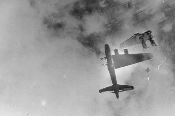 History In Pictures @HistoryInPics  A Boeing B-17F goes down over Crantenburg, Germany after being hit by a Messerschmitt-262. 1945