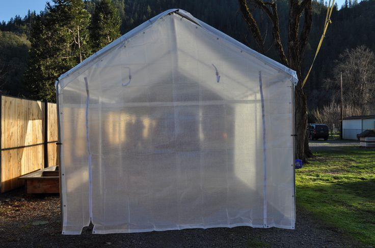 Turn your carport frame into a greenhouse, pictured is a