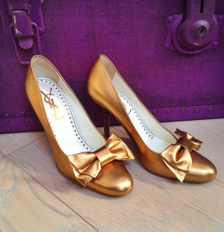 YSL gold leather court shoes.