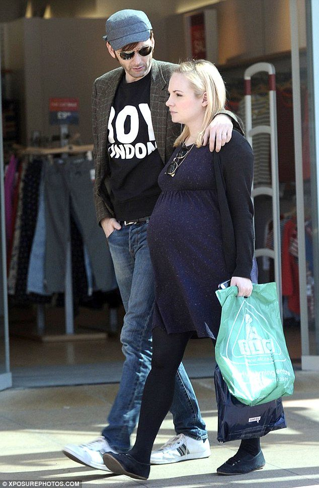 Trying to tell us something? David Tennant wears a BOY London as he takes his pregnant wife Georgia Moffatt baby shopping