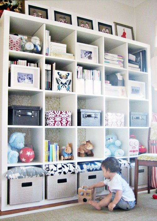 fabric behind open shelving as a room divider