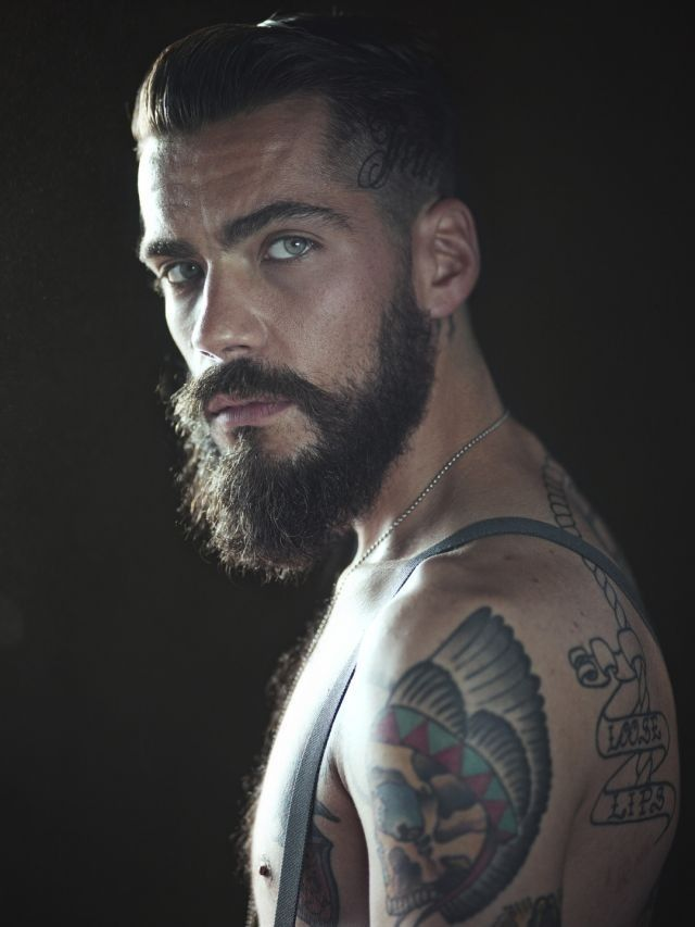 Beard, tats, and gorgeous eyes.. my kind of man!