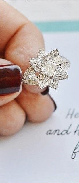 This vintage-inspired halo diamond engagement ring is dazzling.