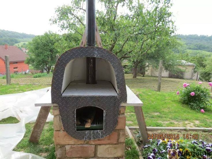Outdoor oven made from old bathtub