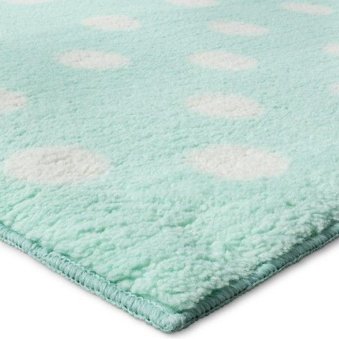 Treat your feet to the Polka Dot Plush Area Rug from Pillowfort. This polka dot throw rug has a luxurious texture and colorful style.
