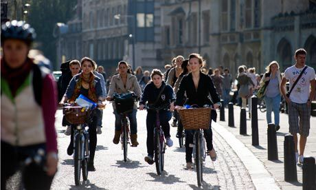 Students cycling in Cambridge