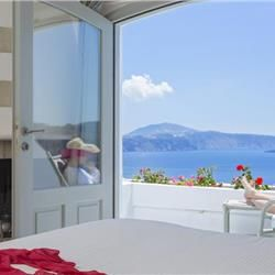 Andronis Boutique Hotel is in the quiet town of Oia, 2.5 miles from Paradisos Beach. The spectacular views of the Caldera are coupled with facilities such as the hotel spa, swimming pool, organic restaurant and personalized services.